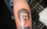 Funny Bad Tattoos 15 Background Wallpaper