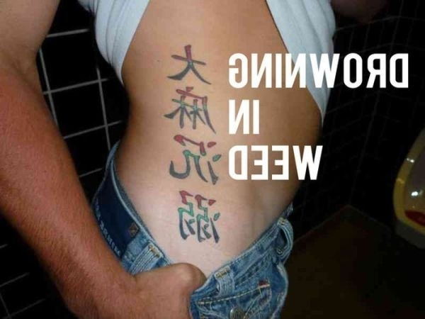 Funny Dumb Tattoos 6 Background Wallpaper